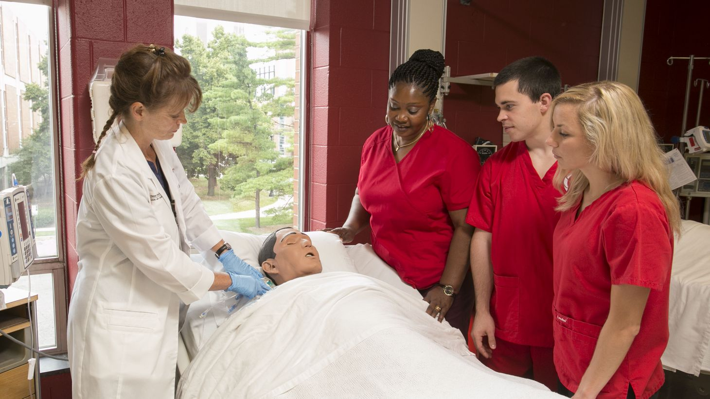 diverse nursing students with instructor