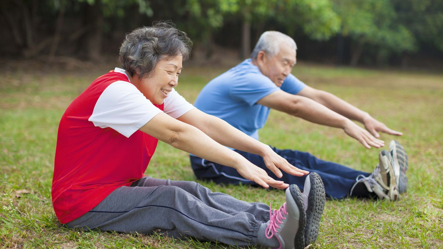 Elderly Asian-American couple stretching
