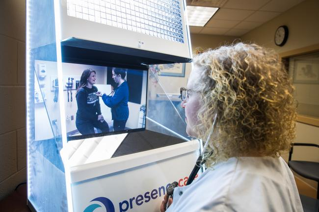 Nurse Practitioner using Telehealth equipment