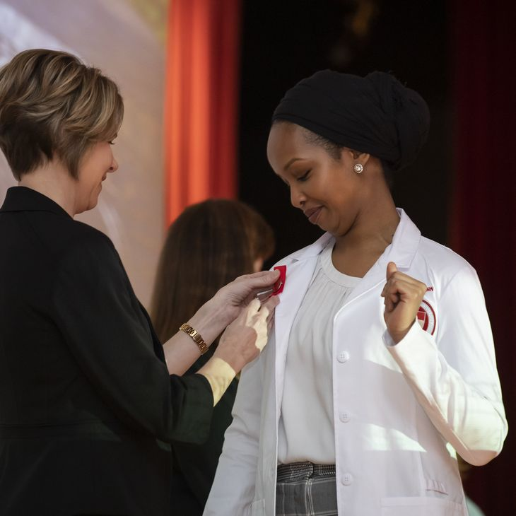 Student receiving pin at 2019 Graduate Entry Pinning and White Coat Ceremony