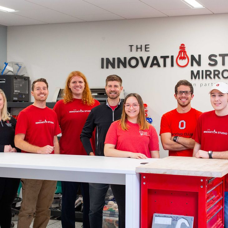 participants posing in the Innovation Studio - Mirror lake