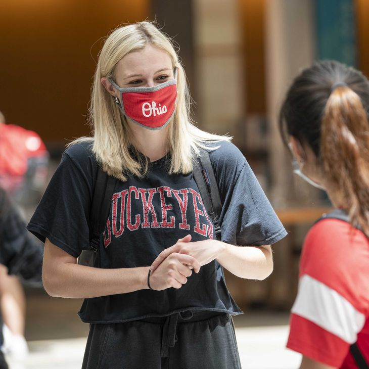 students with mask on campus